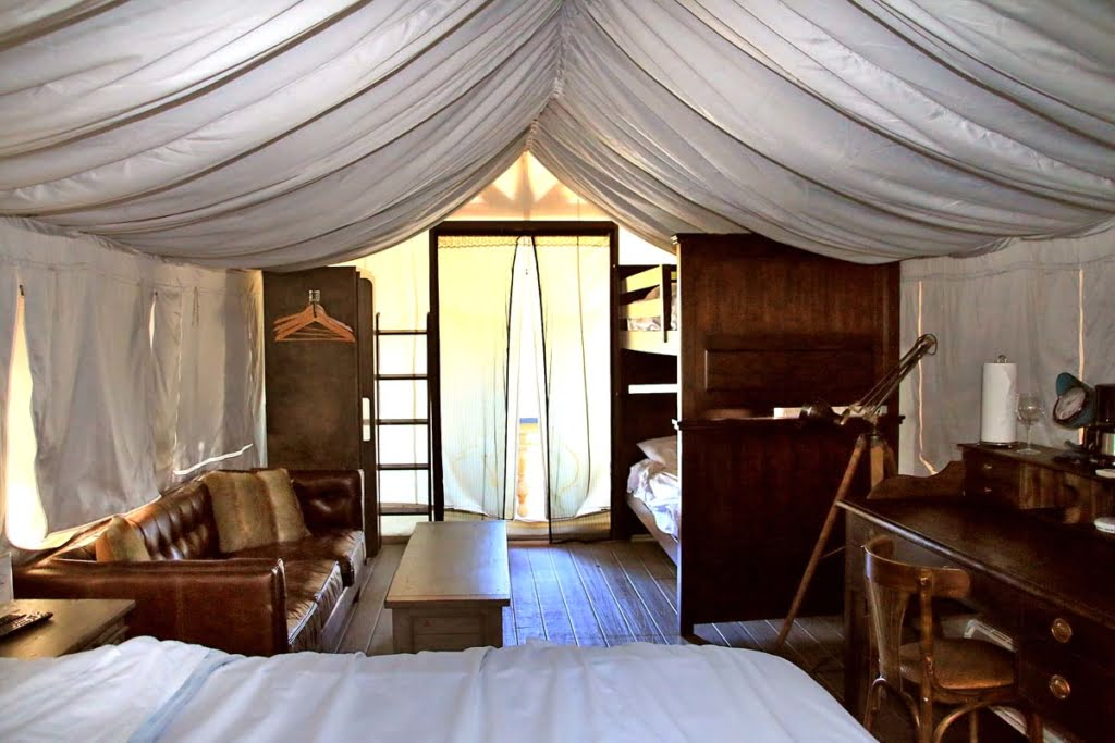 Flying Flags Glamping Resort is the perfect blending of roughing it in a tent in the mountains and a posh hotel. Meet in the middle with your loved ones!